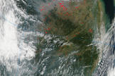 NASA's Aqua satellite captured this image, in which fires in the Chinese countryside appear as red dots, on Oct. 3, 2013.