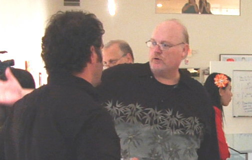 """Paul Madden, who flew in from Detroit for the show, discusses his artwork with a fan. """"I've worked with Elvis and a number of other big-name clients,"""" he said, """"But this show was a lot of fun."""""""