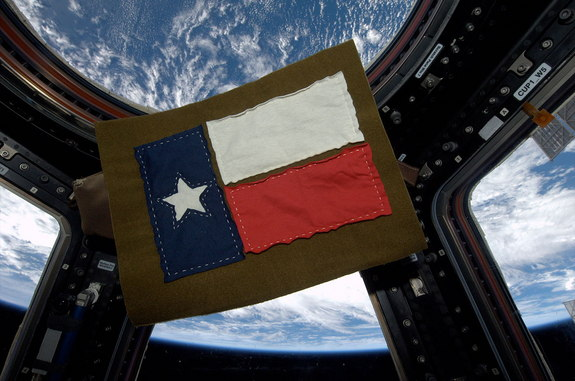 ISS Expedition 37 flight engineer Karen Nyberg sewed this Texas flag from fabric she cut from t-shirts she wore in space.