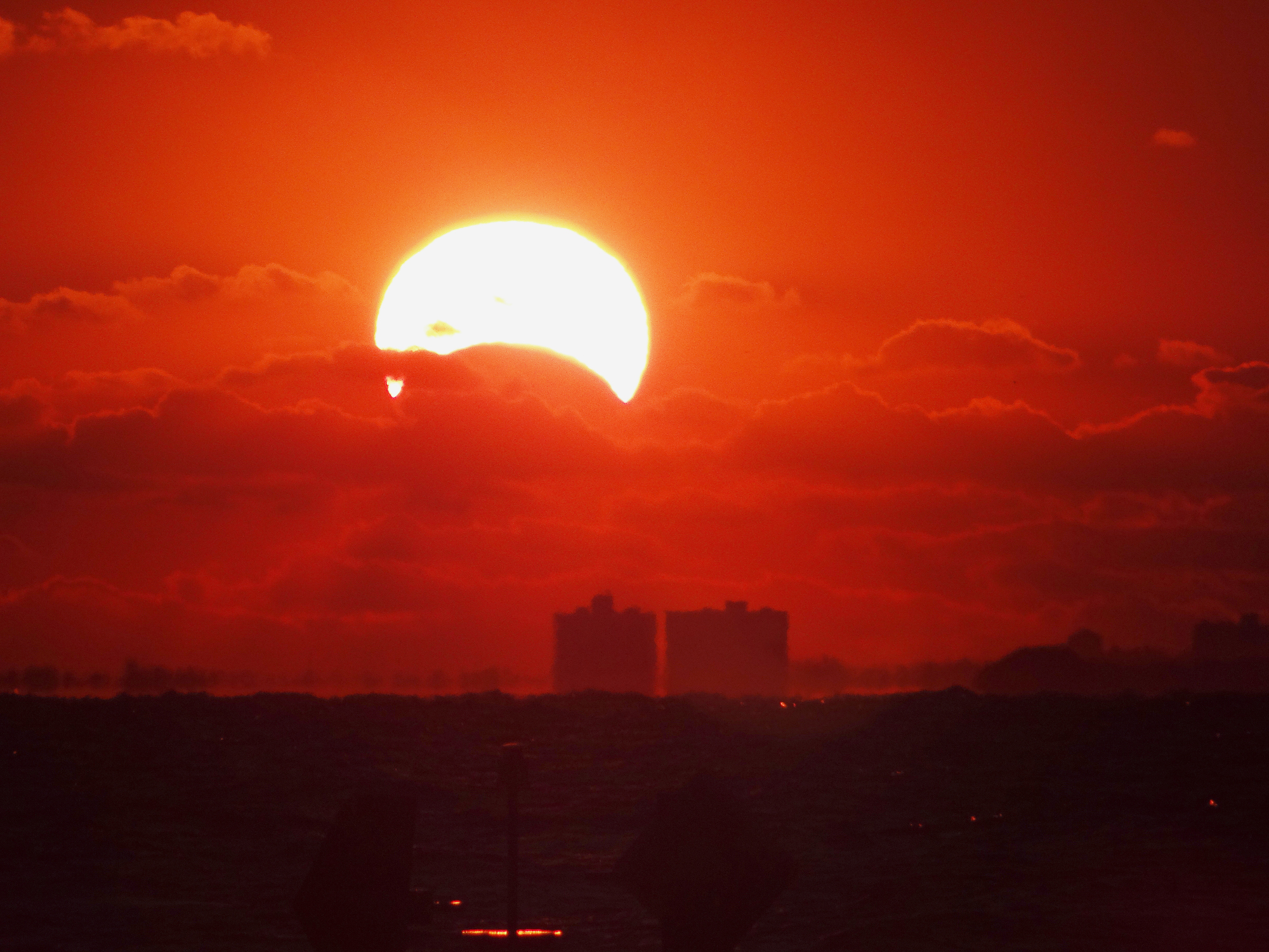 Sunrise Solar Eclipse by James Currie: Nov. 3, 2013
