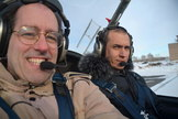 Peter Jenniskens (left) and pilot Eduard Kalinin during an aerial inspection of the fall area. Image released Nov. 6, 2013.