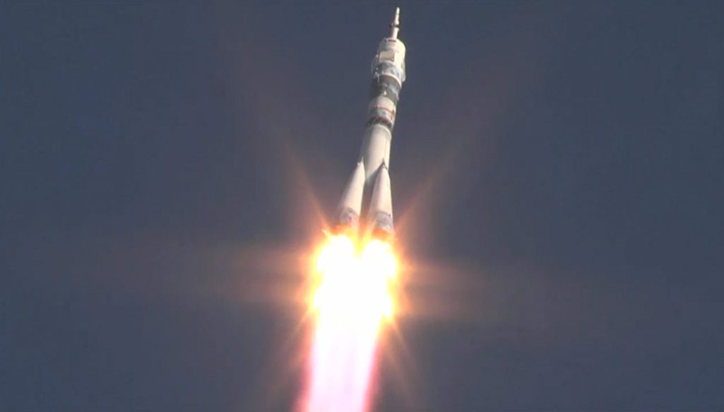 Olympic Torch Launches Into Orbit with New Space Station Crew