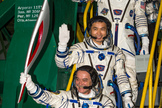 Russian cosmonaut Mikhail Tyurin, Expedition 38 Soyuz commander, holds the Olympic torch as Flight Engineer Koichi Wakata of Japan and Rick Mastracchio of NASA (top) wave farewell prior to boarding the Soyuz TMA-11M rocket for launch, Thursday, Nov. 7, 2013 Local Time, at the Baikonur Cosmodrome in Kazakhstan. The Olympic torch has a four-day visit to the International Space Station.