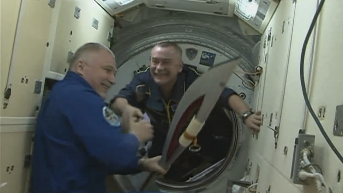 Olympic Torch Handoff on the International Space Station