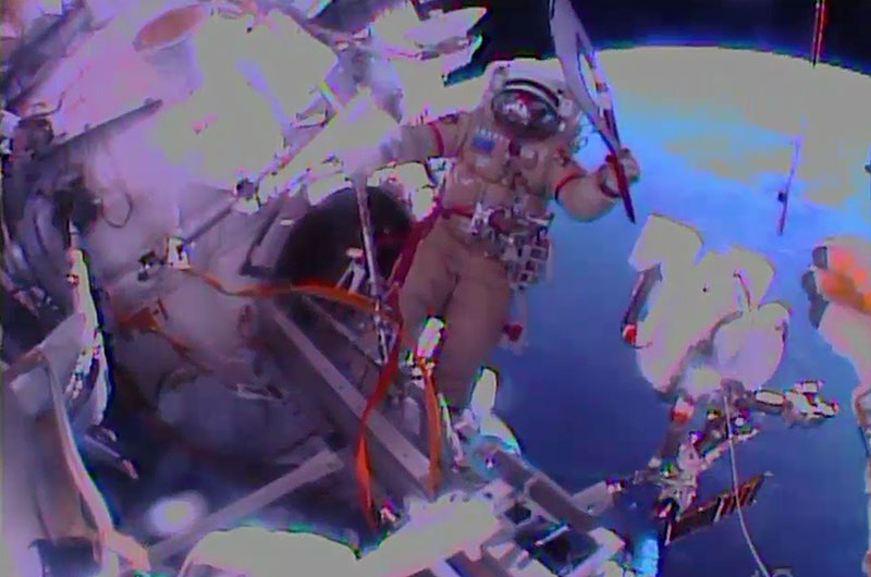 Cosmonaut Oleg Kotov Spacewalks with Olympic Torch