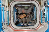 Italian astronaut Luca Parmitano of the European Space Agency plays guitar in weightlessness during his Expedition 37 mission on the International Space Station.
