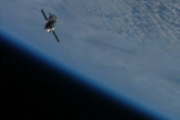 A Soyuz TMA-09M spacecraft is seen by cameras on the International Space Station after the two spacecraft undocked on Nov. 10, 2013. Riding home on the Soyuz were the Olympic torch and Expedition crewmembers Fyodor Yurchikhin of Russia, Karen Nyberg of NASA and Luca Parmitano of the European Space Agency.