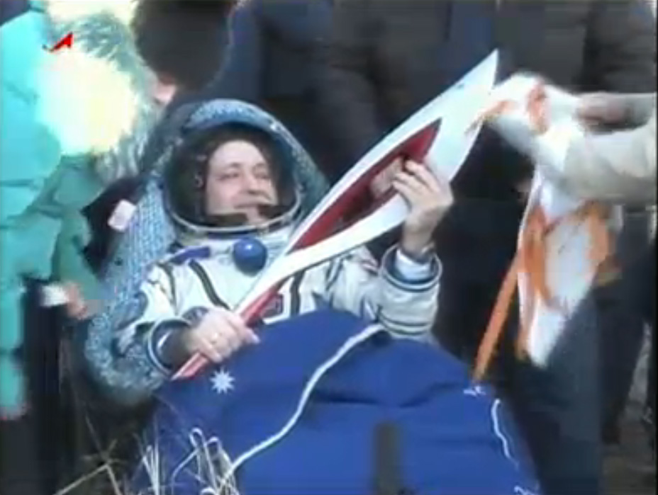 Soyuz Spacecraft Carrying Olympic Torch, Crew of 3 Returns to Earth