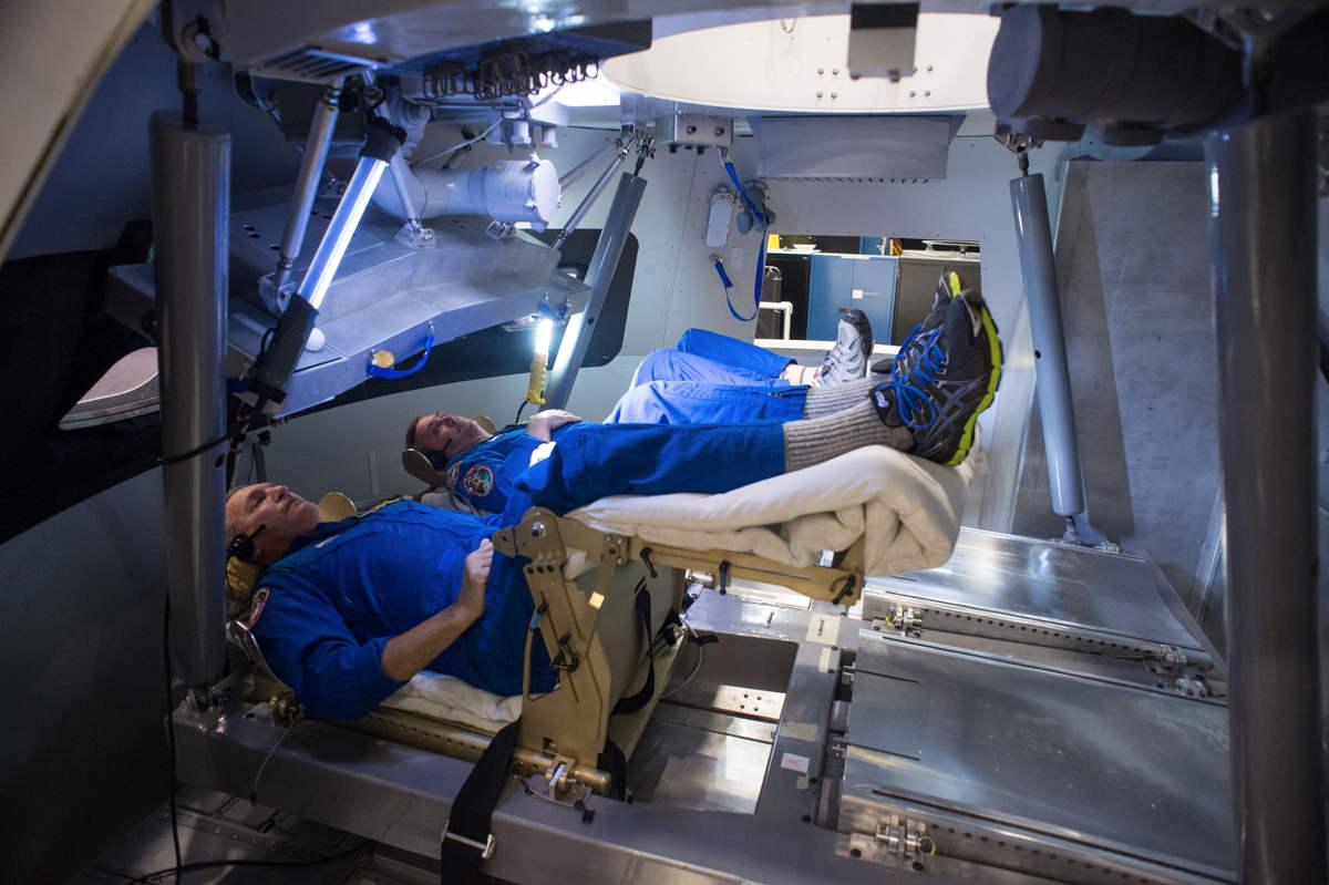 Astronauts Inside Orion Capsule Mockup