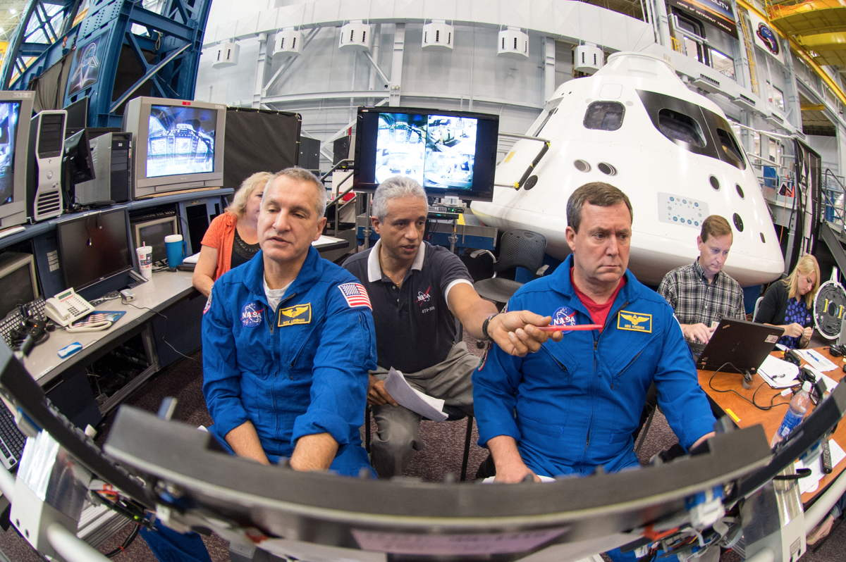 Astronauts Training for Orion Capsule Simulator