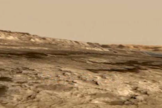 This screenshot from an animated NASA video shows the Murray Buttes, a cluster of steep formations near the base of Mars' Mount Sharp.
