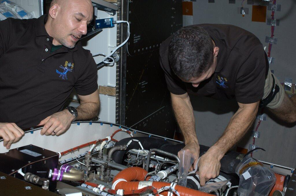 Mike Hopkins and Luca Parmitano Change Valve on ISS
