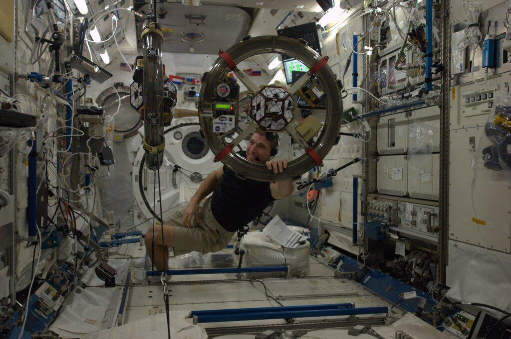 Mike Hopkins with SPHERES Mini Satellites on ISS
