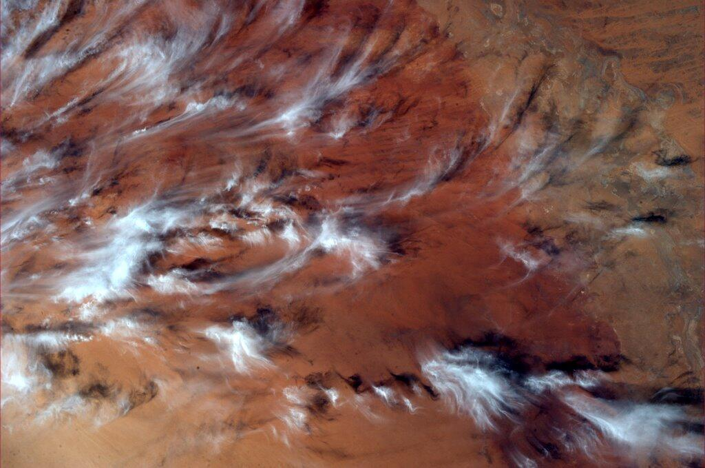 Mike Hopkins on ISS: Clouds Over Red Earth