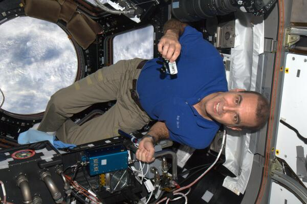 Rick Mastracchio on ISS:  Travel Bug TB5JJN1's First Appearance