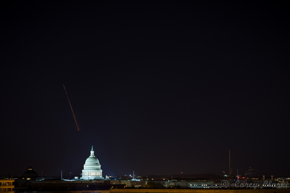 Skywatcher Corey Clarke snapped this 15-second exposure of a Minotaur 1 rocket streaking over the U.S. Capitol Building in Washington, D.C., as seen from the National Academy of Sciences Keck Center on Nov. 19, 2013. The rocket launched from a Mid-Atlantic Regional Spaceport pad at NASA's Wallops Flight Facility in Wallops Island, Va., carrying a record 29 satellites into orbit for the U.S. Air Force's ORS-3 mission.