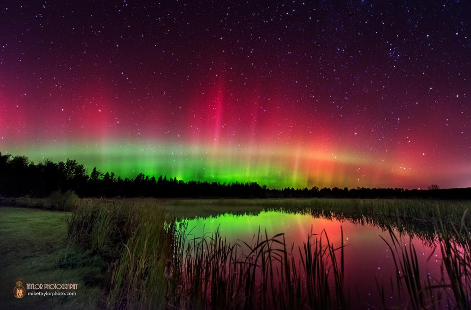 Aurora Borealis Arc Covers Night Sky Over Pond