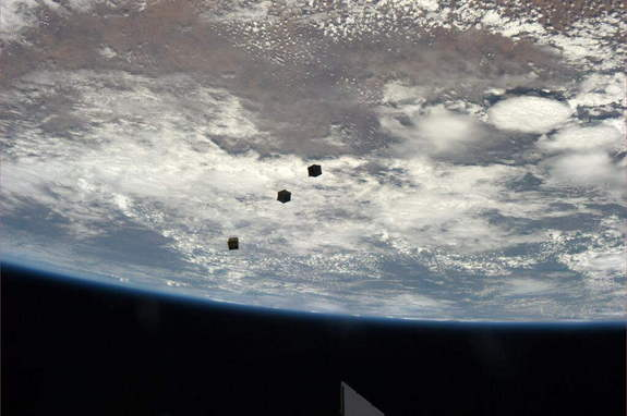 Three small CubeSats float above the Earth after deployment from the International Space Station. Astronaut Rick Mastracchio tweeted the photo from the station on Nov. 19, 2013.