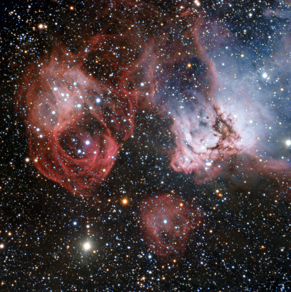 This photo shows the remnants of a stellar explosion (left) and new stars emitting intense radiation that makes clouds of gas glow around them (right) in the Large Magellanic Cloud. Image released Nov. 27, 2013.
