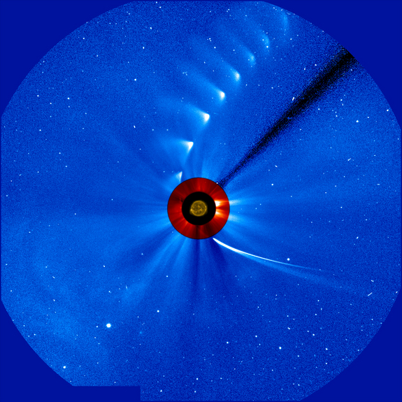 Comet ISON comes in from the bottom right and moves out toward the upper right, getting fainter and fainter, in this time-lapse image from the ESA/NASA Solar and Heliospheric Observatory on Nov. 28, 2013. The image of the sun at the center is from NASA's Solar Dynamics Observatory.