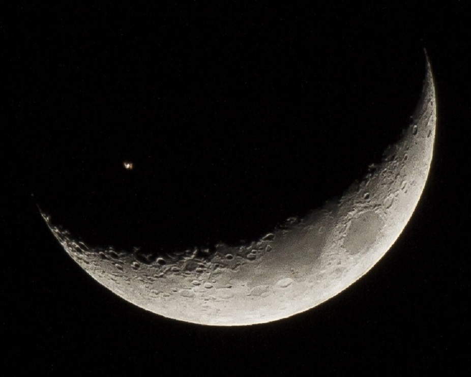 International Space Station Transits Moon by Juan Gonzalez-Alicea