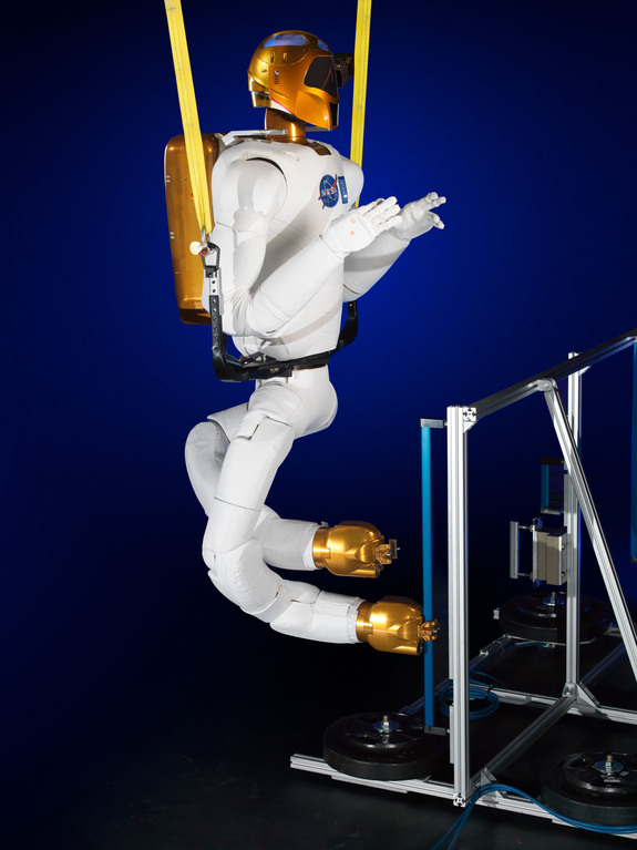 This image shows NASA's Robonaut 2 with newly developed climbing legs, designed to give the robot mobility in zero gravity. With legs, Robonaut 2 will be able to assist astronauts with both hands while keeping at least one leg anchored to the station structure at all times. Image released Nov. 13, 2013.