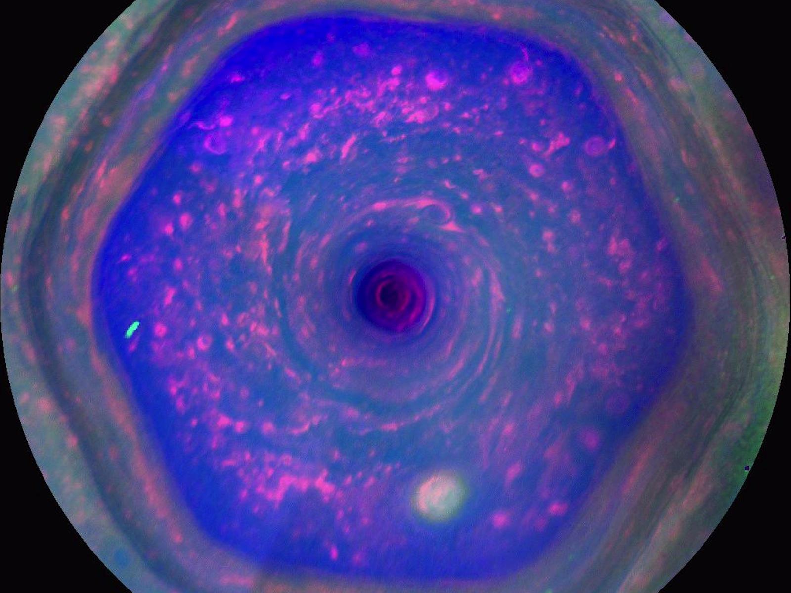 Saturn's Strange Vortex | Space Wallpaper