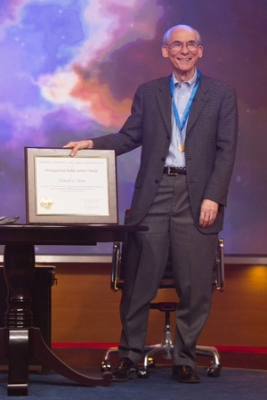 Ed Stone, Project Scientist for NASA's Voyager mission since 1972, stands with his Distinguished Public Service Medal and accompanying certificate. He received the award on the talk show The Colbert Report on Dec. 3, 2013.