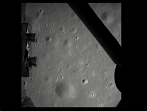 The first photo of the moon by China's Chang'e 3 lunar lander is shown here in this still from a broadcast by the country's state-run CNTV news channel on Dec. 14, 2013. Chang'e 3 delivered the Yutu rover to the moon with its successful landing.