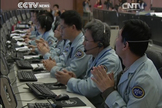 China's Chang'e 3 mission control team applauds after the successful landing of the Chang'e 3 lander carrying the Yutu rover on Dec. 14, 2013. This view is a still from a broadcast by the state-run CNTV.