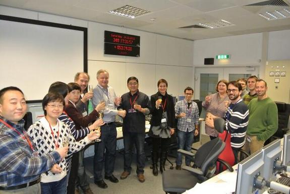 European Space Agency and China National Space Administration teams at the European Space Agency's European Space Operations Centre (ESOC) in Darmstadt, Germany celebrate Chang'e 3's lunar touchdown. ESA ground stations continue to monitor signals from China's lander on the moon.