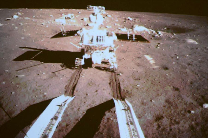 China's Yutu lunar rover is seen by a camera on the country's Chang'e 3 lander after both successfully landed on the moon together on Dec. 14, 2013. It is China's first lunar rover mission and the first soft-landing on the moon in 37 years.