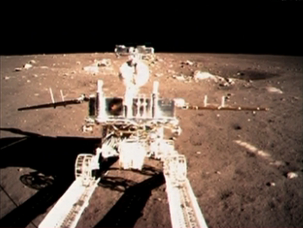 "China's moon rover Yutu (""Jade Rabbit"") rolls down a ramp on the Chang'e 3 lander after touching down on the moon's Bay of Rainbows on Dec. 14, 2013."