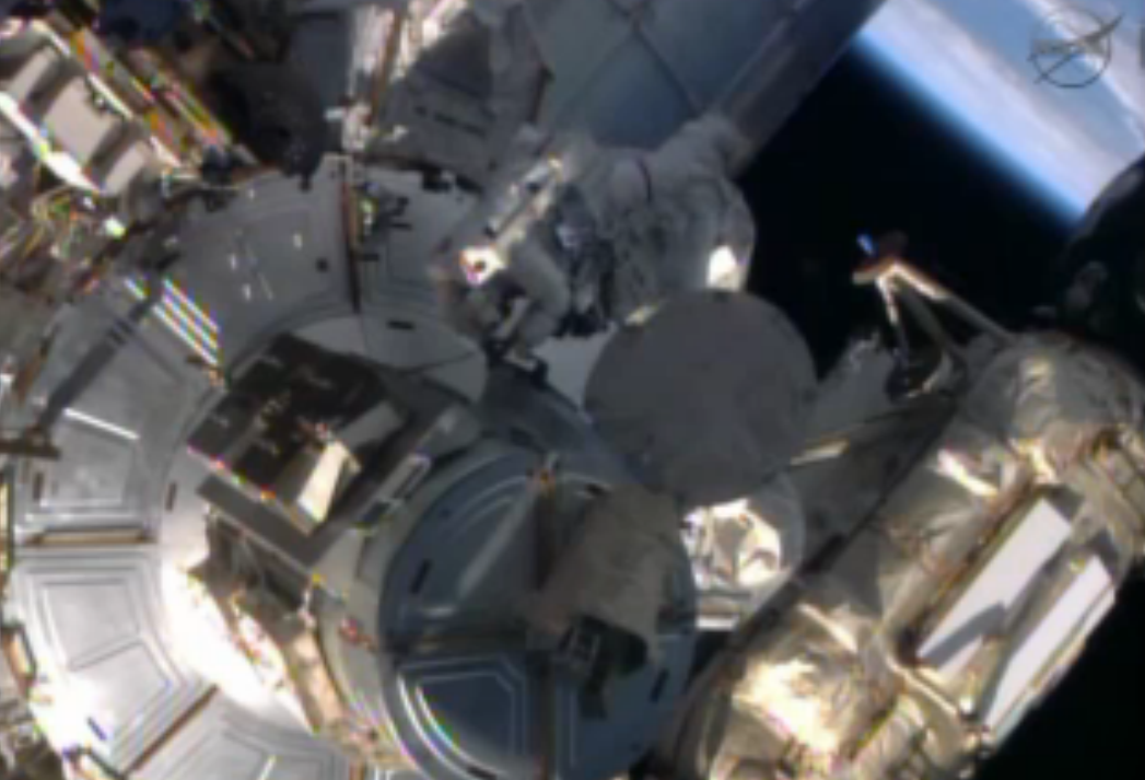 Astronauts Spacewalk Outside Space Station
