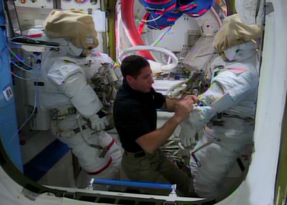Mike Hopkins Works with Spacesuits in Quest Airlock