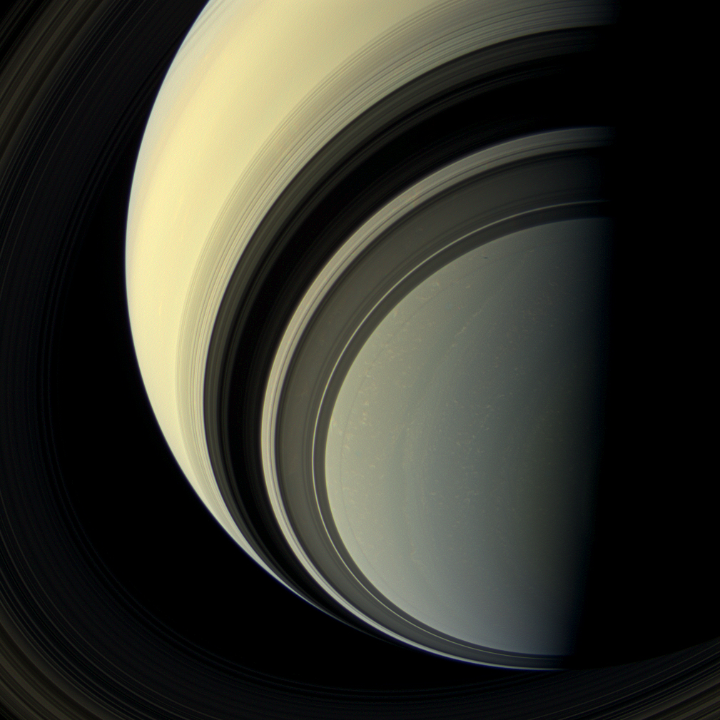 The spectacular rings of Saturn cast dark shadows on the ringed planet as the winter season approaches in Saturn's southern hemisphere in this view from the Cassini spacecraft.