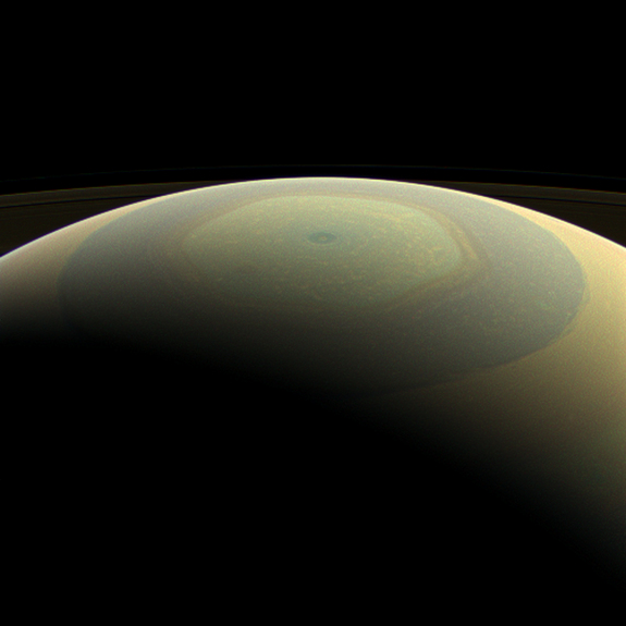 The globe of Saturn, seen here in natural color, is reminiscent of a holiday ornament in this wide-angle view from NASA's Cassini spacecraft. The characteristic hexagonal shape of Saturn's northern jet stream, somewhat yellow here, is visible. At the pole lies a Saturnian version of a high-speed hurricane, eye and all. This image was taken on July 22, 2013 and released on Dec. 23.