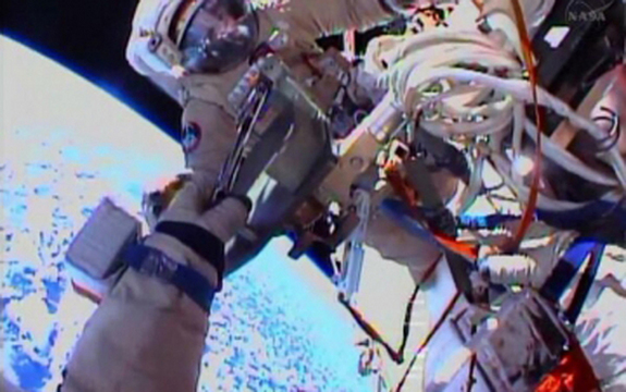 Cosmonauts Oleg Kotov, Expedition 38 commander, and flight engineer Sergey Ryazanskiy perform a spacewalk outside the International Space Station on Dec. 27, 2013. One of the cosmonauts is visible in this view from the other's spacesuit helmet camera.