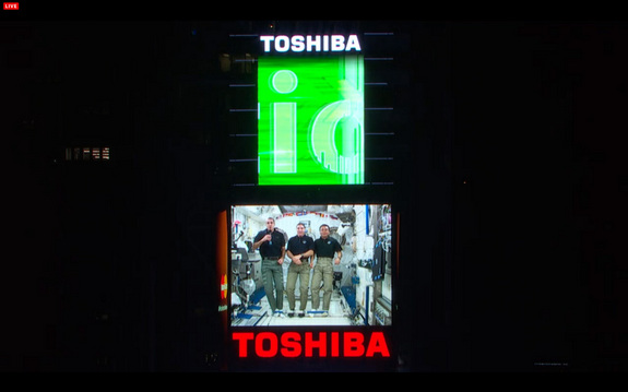 Astronauts on the International Space Station wish Earth a Happy New Year for 2014 in a video message shown in  New York City's Times Square during the New Year's Eve bash on Dec. 31, 2013. From left, they are: Rick Mastracchio and Mike Hopkins, both of NASA, and Koichi Wakata of Japan.