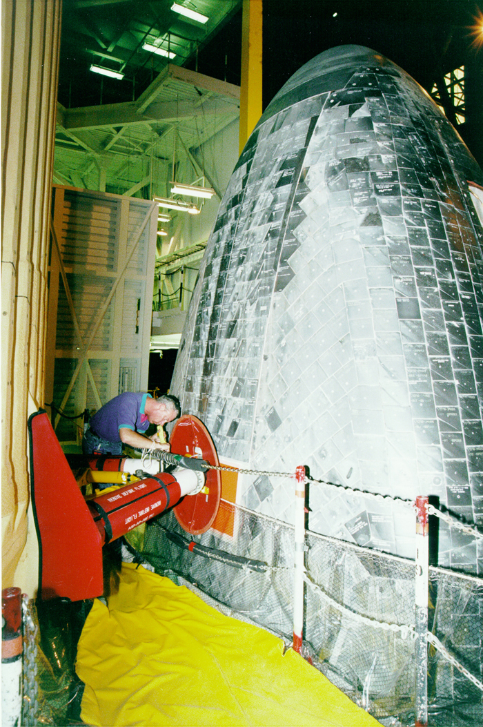 Space History Photo: Discovery External Tank Connection Check