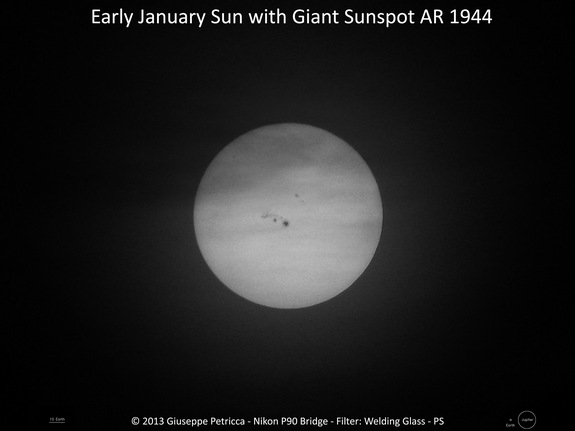 "This image shows the sun with massive sunspot AR 1944 visible near the center of the image. Giuseppe Petricca took this photo on Jan. 7 from Sulmona, Italy using a Nikon P90 bridge camera on a tripod (ISO 64, f/6.3, 1/1200"" exposure)."