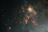 This ground-based view of the Tarantula Nebula shows the nebula in its entirety. It is the brightest region of star formation in the local Universe. Hubble's field of view covers just a tiny spot in the upper-right quadrant of this image, though it reveals detail invisible here, including a supernova remnant. Image released March 15, 2011.