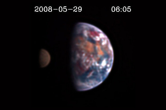 Scientists might one day be capable of discerning land, oceans and clouds on distant planets by looking for reddish, bluish or grayish tints in the color of those worlds. Above is a still image from the EPOXI mission showing the Moon transiting Earth. They are observed at different light wavelengths, which is why differences in details are visible. The first pictures of an Earth-like extrasolar planet will not be this detailed.