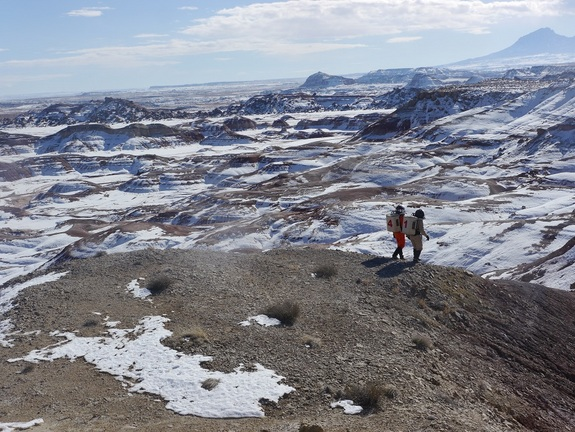 Crew 133 members Matthieu Komorowski (left) and Joseph Jessup walk towards the next stop on their geologic research tour near Utah's Mars Desert Research Station.