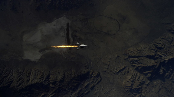 SpaceShipTwo ignites her hybrid rocket motor, as seen from WhiteKnightTwo. During the Jan. 10, 2014, test flight, the rocket motor fired for 20 seconds, accelerating SpaceShipTwo to Mach 1.4, and carrying the vehicle to an altitude of 71,000 feet over Mojave Air & Space Port.