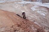 Crew 133 engineer Joseph Jessup navigates a steep hill near Utah's Mars Desert Research Station, Jan. 8, 2014.