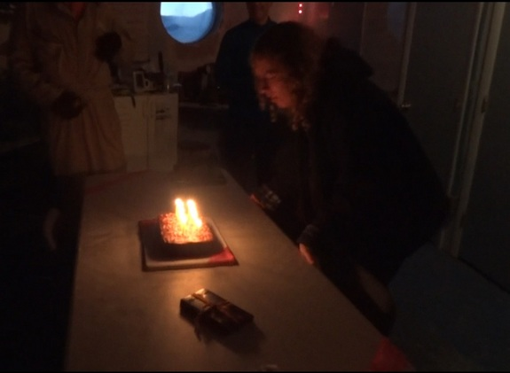 A screenshot from a video shows journalist Elizabeth Howell blowing out the candles on her birthday cake at Utah's Mars Desert Research Station in January 2014.