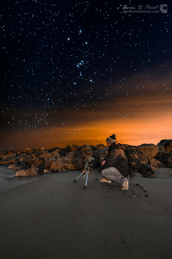 "Night sky photographer Jon Secord is seen photographing the breakwater and night sky on the beach of Wallis Sands State Park in Rye, N.H. on Dec. 28, 2013 as constellation Orion passed overhead. This image was captured by <a href=""http://galleries.aaronpriestphoto.com/Night/""> Aaron Priest </a> of Maine."