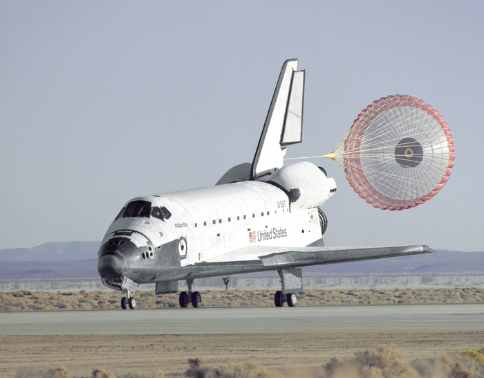 Space History Photo: STS-66 Atlantis Landing and Chute Deployment at Edwards
