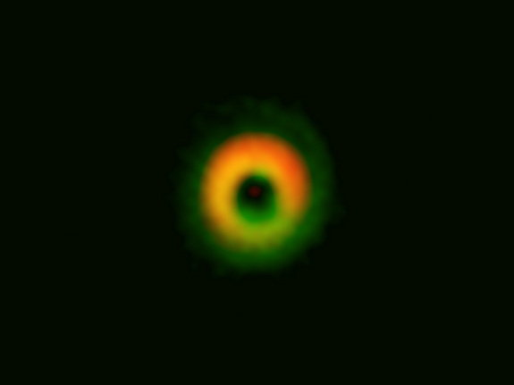 This image by the ALMA radio telescope in Chile shows a giant ring of dust and gas where alien planets may be forming around the star HD142527 about 450 ;light-years from Earth.